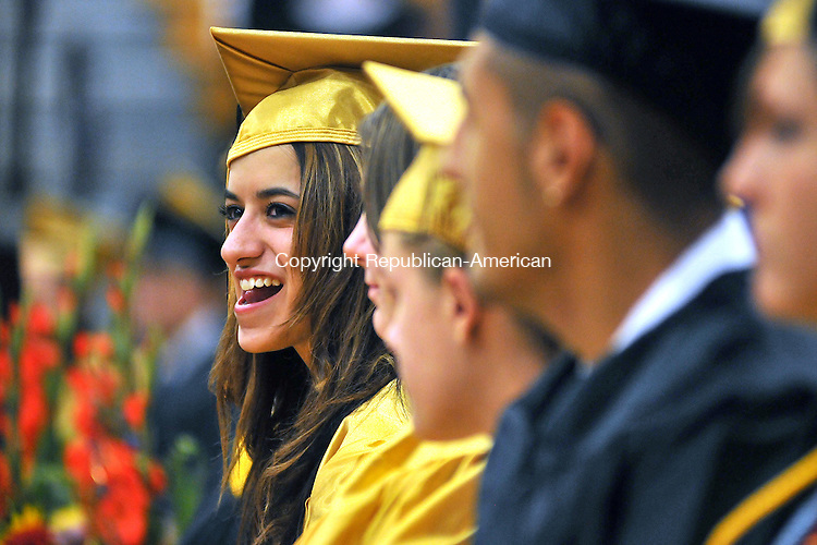 BEACON FALLS, CT, 23 JUNE 2011-062311JS14-- Woodland graduate Ashley Breive, left, smiles to someone she spotted in the crowd during graduation ceremonies Thursday at Woodland Regional High School in Beacon Falls. <br /> Jim Shannon/Republican-American