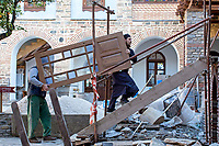 Mount Athos - The Holy Mountain.<br /> A monk helps a general worker to build and repair new parts of the monastery to house the steady influx of pilgrims (visitors). <br /> <br /> Photographer: Rick Findler