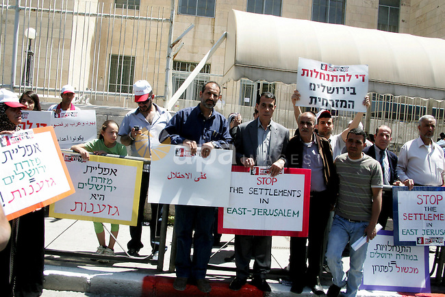 Palestinians  participate in a demonstration supporting Palestinians evicted from their homes in the east Jerusalem on May 11, 2011, outside Jerusalem District Court against the city's plan to destroy homes in Silwan neighborhood. Photo by Mahfouz Abu Turk