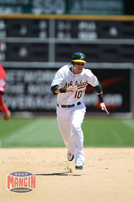 OAKLAND, CA - JUNE 10:  Daric Barton #10 of the Oakland Athletics runs the bases against the Los Angeles Angels of Anaheim during the game at the Oakland-Alameda County Coliseum on June 10, 2010 in Oakland, California. Photo by Brad Mangin
