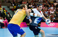 31 JUL 2012 - LONDON, GBR - Steven  Larsson (GBR) of Great Britain (right) finds his path to goal blocked by Mattias Gustafsson (SWE) of Sweden (left) during the men's London 2012 Olympic Games Preliminary round match at The Copper Box in the Olympic Park, in Stratford, London, Great Britain (PHOTO (C) 2012 NIGEL FARROW)