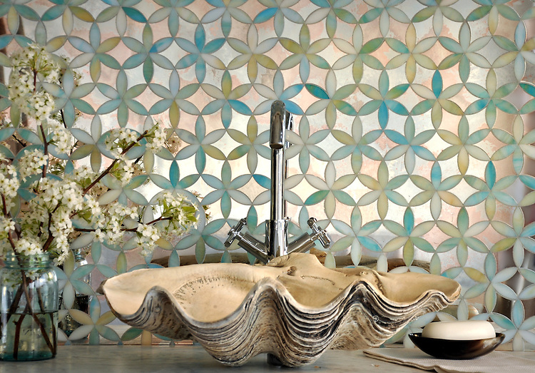 Fiona, a handmade mosaic shown in Aquamarine jewel glass and Dawn mirror, is part of the Silk Road collection by Sara Baldwin for New Ravenna. <br /> For pricing samples and design help, click here: http://www.newravenna.com/showrooms/