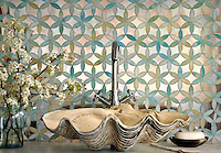 Fiona, a handmade mosaic shown in Aquamarine jewel glass and Dawn mirror, is part of the Silk Road® collection by New Ravenna.