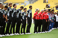 The teams line up for a moment's silence in respect to the victims of the Sri Lankan cricket team bus terrorist attacks in Lahore during the 2nd ODI cricket match between the New Zealand Black Caps and India at Westpac Stadium, Wellington, New Zealand on Friday, 6 March 2009. Photo: Dave Lintott / lintottphoto.co.nz