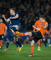 27th December 2019; Dens Park, Dundee, Scotland; Scottish Championship Football, Dundee Football Club versus Dundee United; Danny Johnson of Dundee is tackled by Paul Watson of Dundee United  - Editorial Use