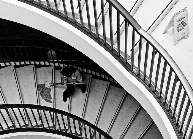 A worker in the Capitol Visitor Center mops the stairs leading down to the Senate meeting rooms Sept. 23, 2010.