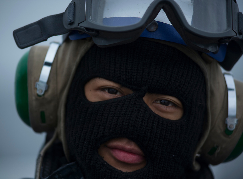 130430-N-DR144-543 Pacific Ocean (April 30, 2013)- Aviation Boatswain's Mate (Handling) Airman Oliver-Jay Espina is dressed for the cold temperatures while scrubbing the flight deck aboard San Antonio-class amphibious transport dock ship USS Anchorage (LPD 23) as the ship approaches the Alaska coast. Anchorage is currently en route to its namesake city of Anchorage, Alaska for its commissioning ceremony May 4. (U.S. Navy photo by Mass Communication Specialist 1st Class James R. Evans / RELEASED)