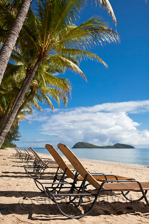 Sun lounges on the beach at Palm Cove, Cairns, Queensland, Australia