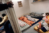 Illegal immigrants from Sierra Leone sleep in a Muslim safe-house Amsterdam's Bijlmer area. .Picture taken 2002 by Justin Jin. ..