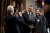United States President Barack Obama stands with keynote speaker Eric Metaxas as Vice President Joe Biden takes their photo during the National Prayer Breakfast at the Washington Hilton Hotel in Washington, D.C., February 2, 2012. .Mandatory Credit: Pete Souza - White House via CNP