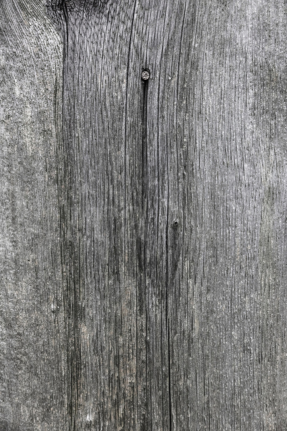 Unfinished wood plank detail.