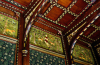 A detail of the hand-blocked wallpaper, painted panels and elaborate beamed ceiling in the living room of Wightwick Manor