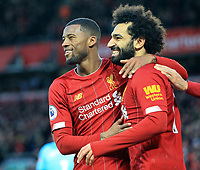 1st February 2020; Anfield, Liverpool, Merseyside, England; English Premier League Football, Liverpool versus Southampton; Mohammed Salah of Liverpool celebrates with team mate Georginio Wijnaldum of Liverpool after scoring his side's third goal