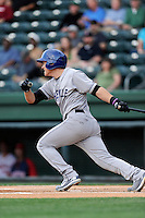 Shortstop Patrick Valaika (16) of the Asheville Tourists bats in a game against the Greenville Drive on Monday, April 21, 2014, at Fluor Field at the West End in Greenville, South Carolina. Greenville won, 8-3. (Tom Priddy/Four Seam Images)