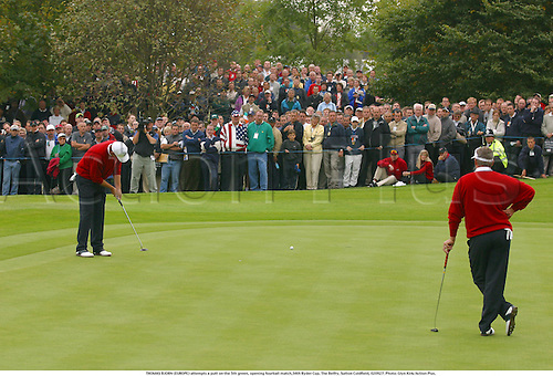 THOMAS BJORN (EUROPE) attempts a putt on the 5th green, opening fourball match,34th Ryder Cup, The Belfry, Sutton Coldfield, 020927. Photo: Glyn Kirk/Action Plus....Golf golfer player 2002.putts putting..........