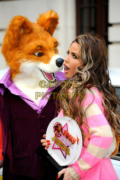 Katie Price (Jordan).Winner of the Foxy Bingo Celebrity Mum of the Year 2012, Chancery Court Hotel, Holborn, London, England..March 15th, 2012.half length pink beige striped stripes top award trophy costume mouth open side   fox nose.CAP/CJ.©Chris Joseph/Capital Pictures.