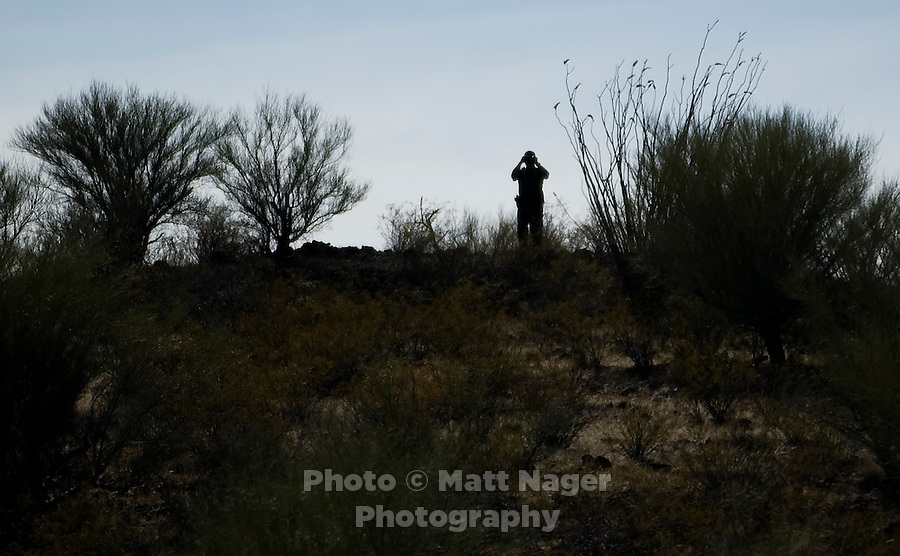 A BORSTAR agent searches for unidentified migrants in the desert near Highway 286 and 86 in Tucson, Arizona, Friday, June 10, 2009. BORSTAR agents are specially trained in search and rescue techniques, tracking methods, and surveillance methods designed to stop illegal immigration in the desert and help find distressed migrants lost in the desert many miles from roads or housing communities...PHOTOS/ MATT NAGER