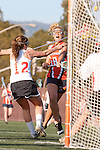 Santa Barbara, CA 02/13/10 - A Pepperdine player and Bronte Baynes (Chico State #12) in action during the Chico State-Pepperdine game at the 2010 Santa Barbara Shoutout, Chico State defeated Pepperdine 14-9.