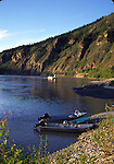 Boats and ferry on Yukon River in Dawson City