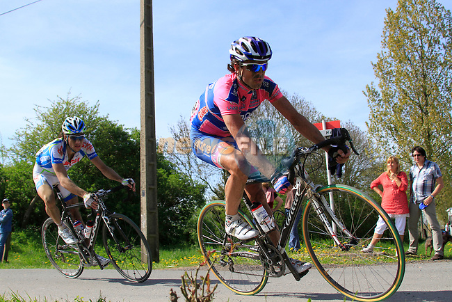 Daniele Righi (ITA) Lampre-ISD and Roy Curvers (NED) Skil-Shimano race through the village of Ennevelin during the 109th edition of the Paris-Roubaix cycle race, 10th April 2011 (Photo by Eoin Clarke/NEWSFILE)