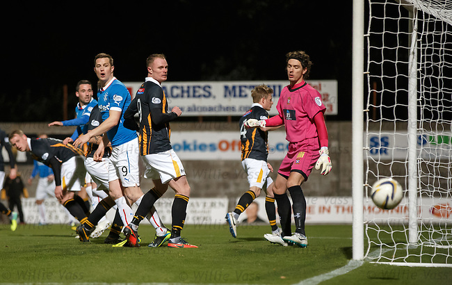 Jon Daly watches his header just skim the outside of the post