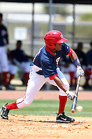 GCL Nationals Narciso Mesa #11 bunts the ball during a game against the GCL Mets at the Washington Nationals Minor League Complex on June 20, 2011 in Melbourne, Florida.  The Nationals defeated the Mets 5-3.  (Mike Janes/Four Seam Images)