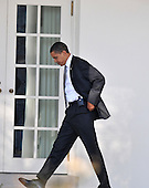 Washington, DC - January 29, 2009 -- United States President Barack Obama walks with his Blackberry on his belt as he returns to the Oval Office at the White House in Washington, D.C. after going to Sidwell Friends School in Bethesda, Maryland for a class presentation for his his daughter Sasha on Thursday, January 29, 2009..Credit: Ron Sachs - Pool via CNP