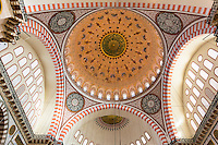 Ornate domes in interior of Suleymaniye Mosque in Istanbul, Republic of Turkey