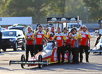 Aug 15, 2014; Brainerd, MN, USA; Crew members with NHRA top fuel dragster driver Doug Kalitta in the staging lanes during qualifying for the Lucas Oil Nationals at Brainerd International Raceway. Mandatory Credit: Mark J. Rebilas-