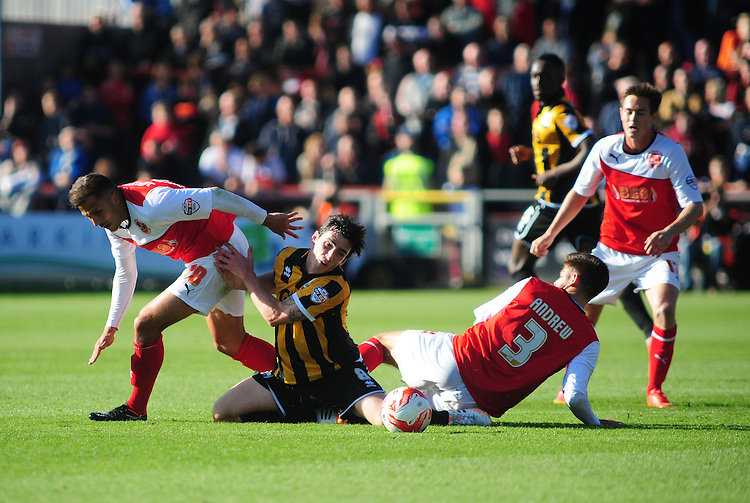 Port Vale's Louis Dodds is tackled by Fleetwood Town's Antoni Sarcevic, left, and Fleetwood Town's Danny Andrew<br /> <br /> Photographer Chris Vaughan/CameraSport<br /> <br /> Football - The Football League Sky Bet League One - Fleetwood Town v Port Vale - Saturday 04th October 2014 - Highbury Stadium - Fleetwood<br /> <br /> &copy; CameraSport - 43 Linden Ave. Countesthorpe. Leicester. England. LE8 5PG - Tel: +44 (0) 116 277 4147 - admin@camerasport.com - www.camerasport.com