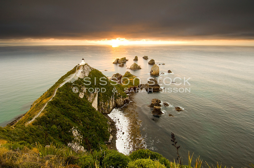 Nugget Point lighthouse at dawn looking out to sea, The Catlins, Otago