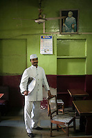 Mr Sri Kumar, a waiter in the Indian Coffee House. Originally from Kerala, Mr Kumar has worked at the Coffee House for eight years.