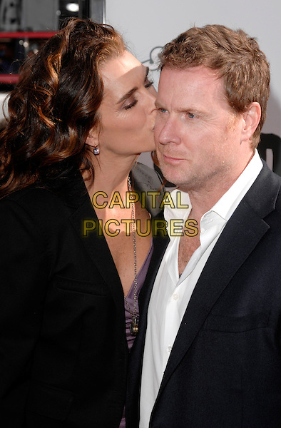 "BROOKE SHIELDS & CHRIS HENCHY.""Land Of The Lost"" Los Angeles Premiere held at Grauman's Chinese Theatre, Hollywood, CA, USA. .May 30th, 2009 .half length black jacket purple top married husband wife white kiss kissing cheek .CAP/ROT.©Lee Roth/Roth Stock/Capital Pictures"