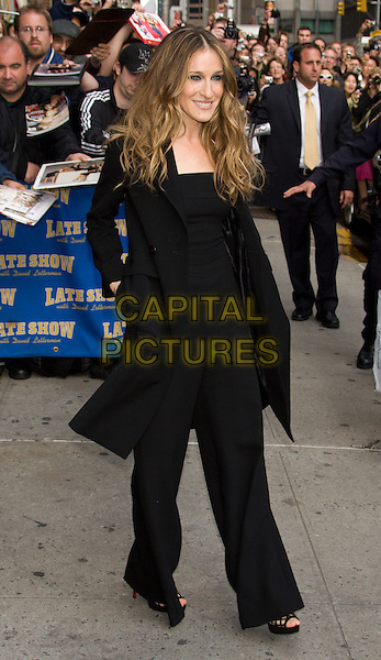"""SARAH JESSICA PARKER.Appearance on the """"Late Show with David Letterman"""" at the Ed Sullivan Theater, New York, NY, USA..May 22nd, 2008.SJP full length black coat jacket top trousers wide leg catsuit jumpsuit hands in pockets .CAP/LNC/TOM.©TOM/LNC/Capital Pictures."""