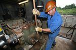 Worker on salt drilling rig, Netherlands