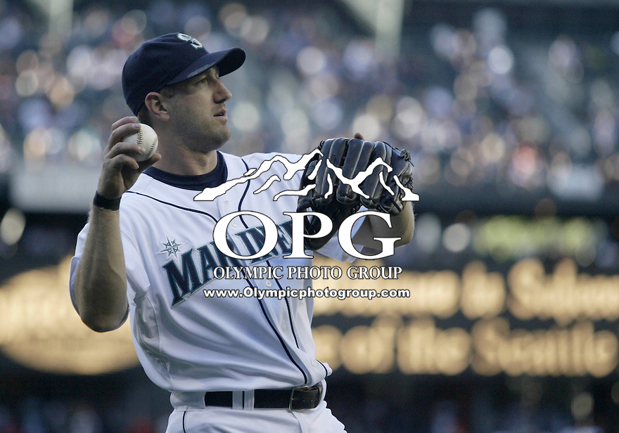 01 August 2007:   Seattle Mariners utility player Willie Bloomquist warms up before the game against the Los Angeles Angels at Safeco Field. Seattle won 8-7 in 12 innings.
