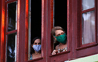 HAVANA, CUBA - April 15: Women wearing face masks look at cuban soldiers disinfect sidewalks and streets in downtown in Havana, Cuba, on April 15, 2020. The military soldiers carry out a disinfection process in the city, applicable in parks, commercial areas, atriums, transportation stations and general public meeting places  decreed by the Government to contain the expansion of COVID. 19. (Photo by Eliana Aponte/VIEWpress)