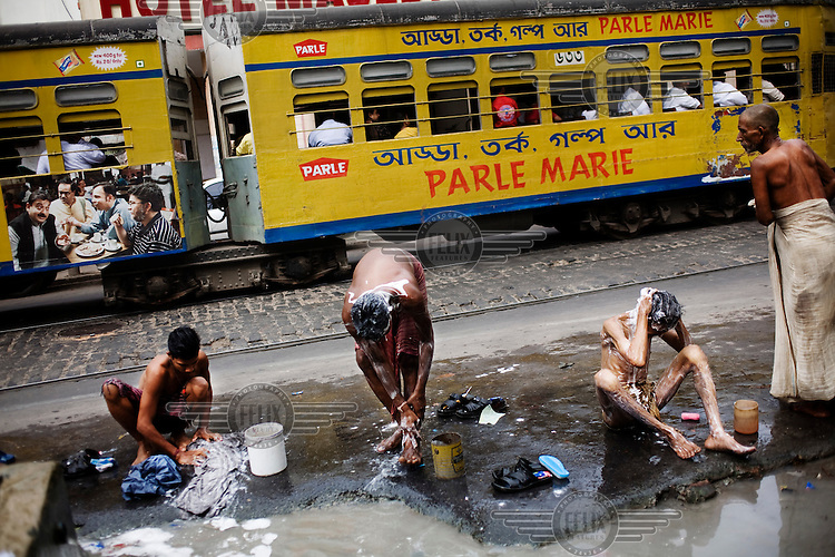 Men wash on a street in Calcutta.