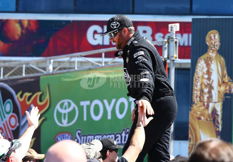 June 1, 2014; Englishtown, NJ, USA; NHRA top fuel driver Shawn Langdon during the Summernationals at Raceway Park. Mandatory Credit: Mark J. Rebilas-