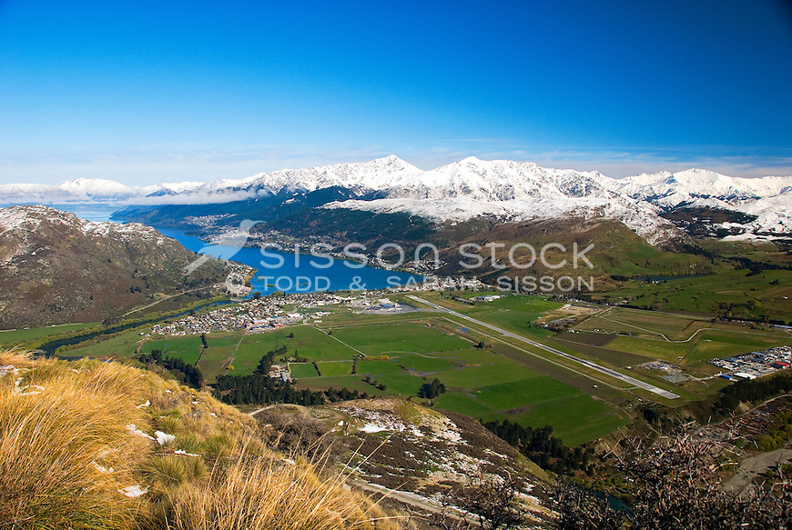 Looking down on the Queenstown airport, Frankton, Lake Wakatipu and Queenstown from the Remarkables road, South Island, New Zealand
