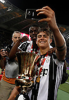Calcio, finale Tim Cup: Milan vs Juventus. Roma, stadio Olimpico, 21 maggio 2016.<br /> Juventus&rsquo; Paul Pogba, left, and Paulo Dybala take a selfie with the trophy at the end of the Italian Cup final football match between AC Milan and Juventus at Rome's Olympic stadium, 21 May 2016. Juventus won 1-0 in the extra time.<br /> UPDATE IMAGES PRESS/Isabella Bonotto