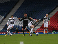 John McGinn gets the better of Gary Hooper as Graham Carey (left) and Jim Goodwin watch in the St Mirren v Celtic Scottish Communities League Cup Semi Final match played at Hampden Park, Glasgow on 27.1.13.