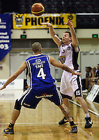 Heat guard Daniel Munday puts the ball up over Lindsay Tait during the National Basketball League match Wellington Saints and Harbour Heat at TSB Bank Arena, Wellington, New Zealand on Saturday 13 June 2009. Photo: Dave Lintott / lintottphoto.co.nz