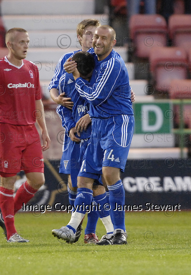 26/07/2007       Copyright Pic: James Stewart.File Name : sct_jspa12_dunfermline_v_notts_forest.OWEN MORRISON IS CONGRATULATED BY JIM MCINTYRE AFTER HE SCORES DUNFERMLINE'S SECOND.James Stewart Photo Agency 19 Carronlea Drive, Falkirk. FK2 8DN      Vat Reg No. 607 6932 25.Office     : +44 (0)1324 570906     .Mobile   : +44 (0)7721 416997.Fax         : +44 (0)1324 570906.E-mail  :  jim@jspa.co.uk.If you require further information then contact Jim Stewart on any of the numbers above.........