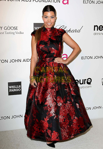 Kourtney Kardashian.The 21st Annual Elton John AIDS Foundation Academy Awards Viewing Party held at The City of West Hollywood Park in West Hollywood, California, USA..February 24th, 2013.oscars full length dress hand on hip red black embroidered floral print .CAP/ADM/KB.©Kevan Brooks/AdMedia/Capital Pictures.