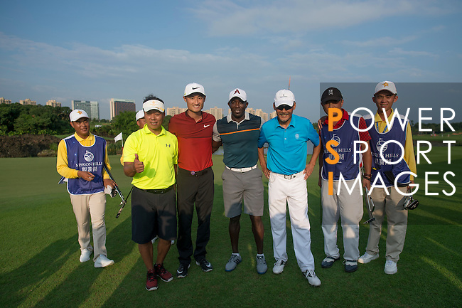 Li Haotong of China (in red), Zhao Hongbo (in yellow), Dwight Yorke (in navy blue) and He Ping (in blue) at the end of their game during the World Celebrity Pro-Am 2016 Mission Hills China Golf Tournament on 23 October 2016, in Haikou, Hainan province, China. Photo by Marcio Machado / Power Sport Images