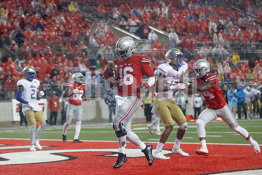Ohio State Buckeyes quarterback J.T. Barrett (16) trots in for a touchdown during the fourth quarter of the NCAA football game between the Ohio State Buckeyes and the Tulsa Golden Hurricane at Ohio Stadium on Saturday, September 10, 2016. (Columbus Dispatch photo by Jonathan Quilter)