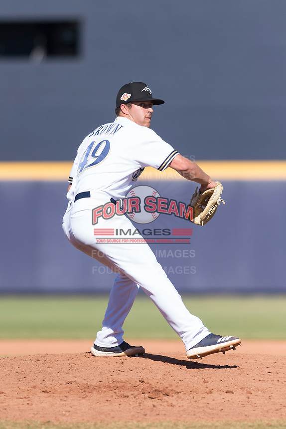 Peoria Javelinas relief pitcher Daniel Brown (49), of the Milwaukee Brewers organization, delivers a pitch during an Arizona Fall League game against the Glendale Desert Dogs at Peoria Sports Complex on October 22, 2018 in Peoria, Arizona. Glendale defeated Peoria 6-2. (Zachary Lucy/Four Seam Images)