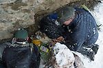 Snow Leopard (Panthera uncia) biologist, Shannon Kachel, veterinarian, John Ochsenreiter, and ranger, Ulan Abulgaziev, during collaring of male, Sarychat-Ertash Strict Nature Reserve, Tien Shan Mountains, eastern Kyrgyzstan