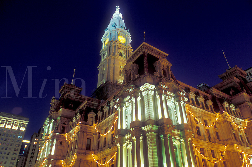 City Hall, Philadelphia, Pennsylvania, PA, City Hall at Center Square decorated for the Christmas holidays in downtown Philadelphia in the evening.